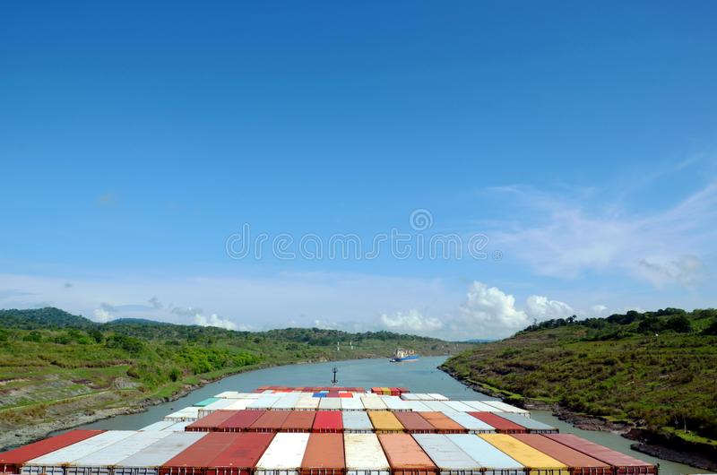 Container ship transiting through Panama Canal. Container ship transiting through Panama Canal on a sunny day, view from the navigation bridge royalty free stock photo