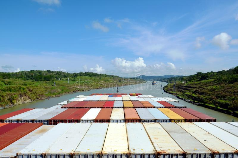 Container ship transiting through Panama Canal. Container ship transiting through Panama Canal on a sunny day, view from the navigation bridge stock photo