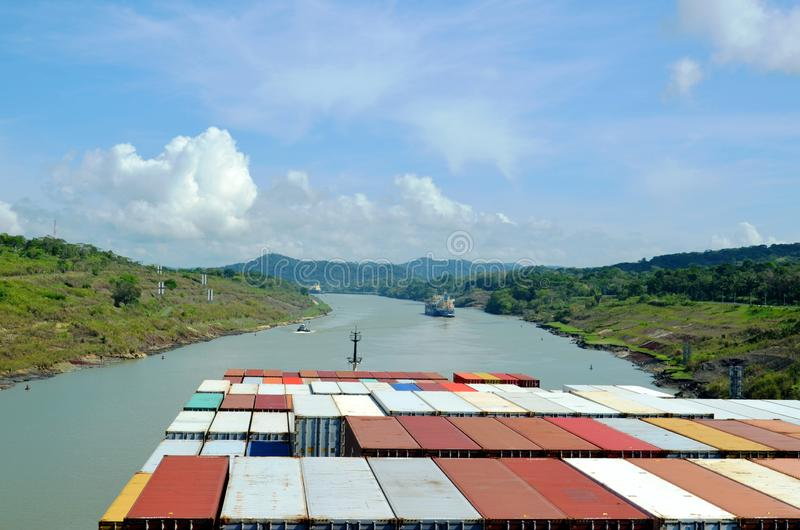 Container ship transiting through Panama Canal. Container ship transiting through Panama Canal on a sunny day, view from the navigation bridge stock images