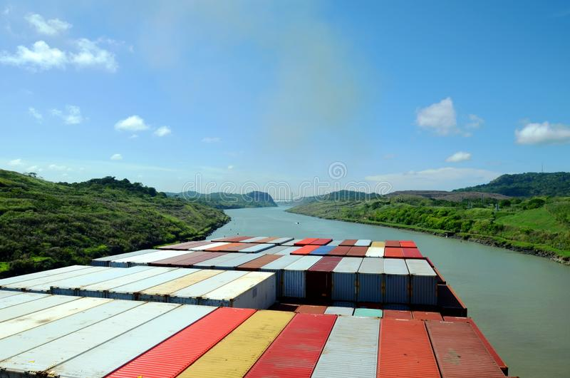 Container ship transiting through Panama Canal. Container ship transiting through Panama Canal on a sunny day, view from the navigation bridge to the vessels stock photos