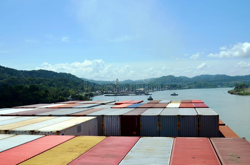 Container ship transiting through Panama Canal. Container ship transiting through Panama Canal on a sunny day, view from the navigation bridge to the vessels stock photo