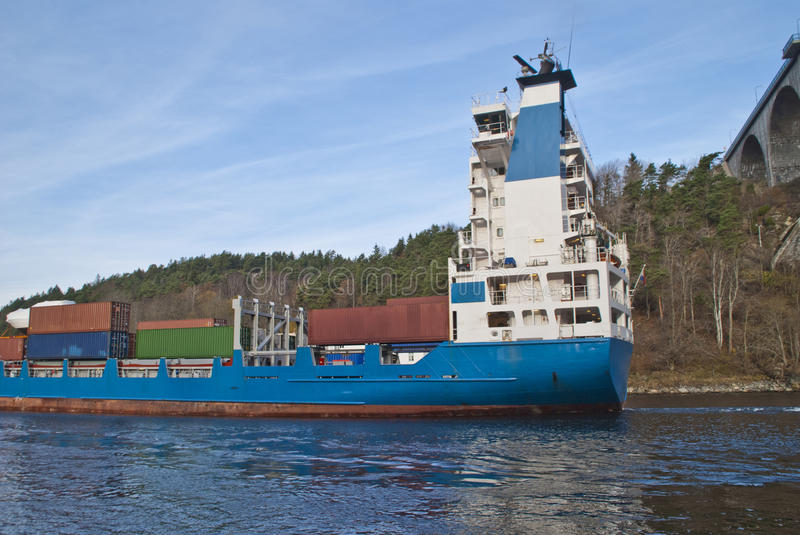 Container ship under svinesund bridge, image 6. While i'm under svinesund bridge (which is a bridge that borders between norway and sweden) shows the container stock image