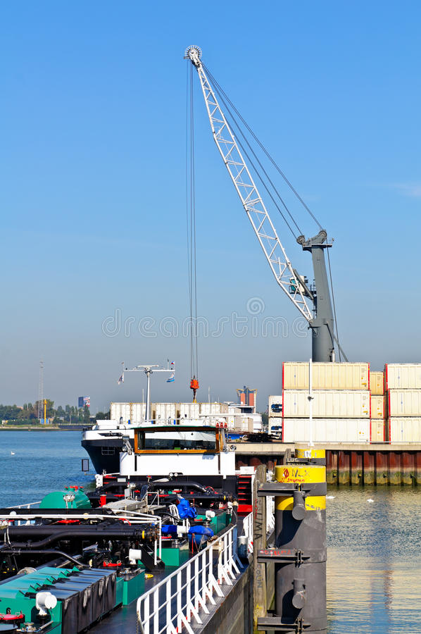 Download Container Ship Unloading In The Harbor Stock Photography - Image: 21387832