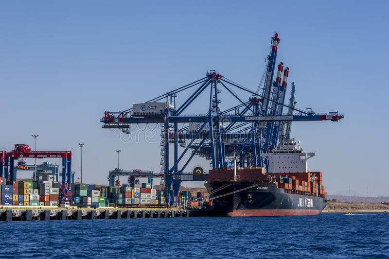 A container ship unloads it cargo at the Aqaba Container Terminal on the Gulf of Aqaba in Jordan. royalty free stock photography