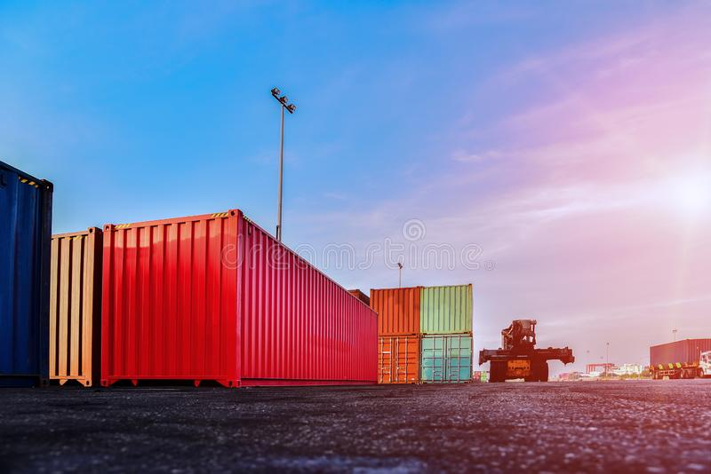 Container in shipping yard of dockyard  stacked  for transport. royalty free stock image