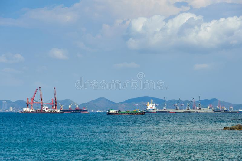 Container ships anchor along a deep seaport in daylight royalty free stock photo