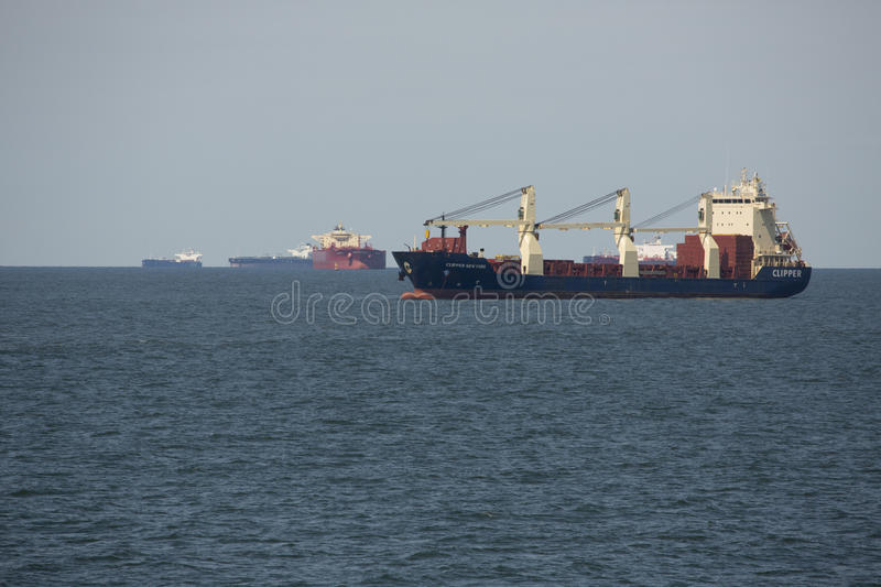 Container ships at anchor waiting at mouth of Delaware River. royalty free stock photo