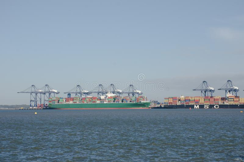 Container Ships in Flexistowe Harbour Looking from Harwich. Harwich Essex United Kingdom -16 November 2017: Container Ships in Flexistowe Harbour Looking from royalty free stock images