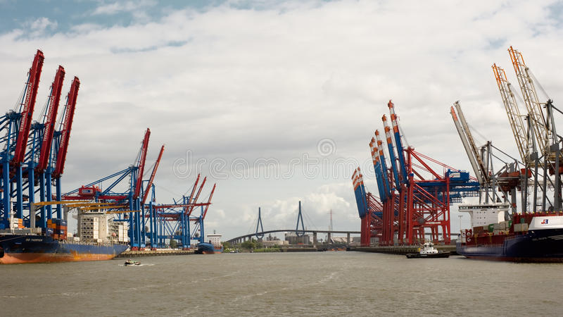 Container Terminal Hamburg. Hamburg, Germany - May 14, 2016: View of Container Terminal Burchardkai and Eurogate in Harbor Hamburg with Koehlbrand Bridge in stock image