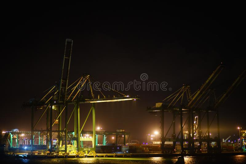 Container terminal in the port with huge cranes stock photos