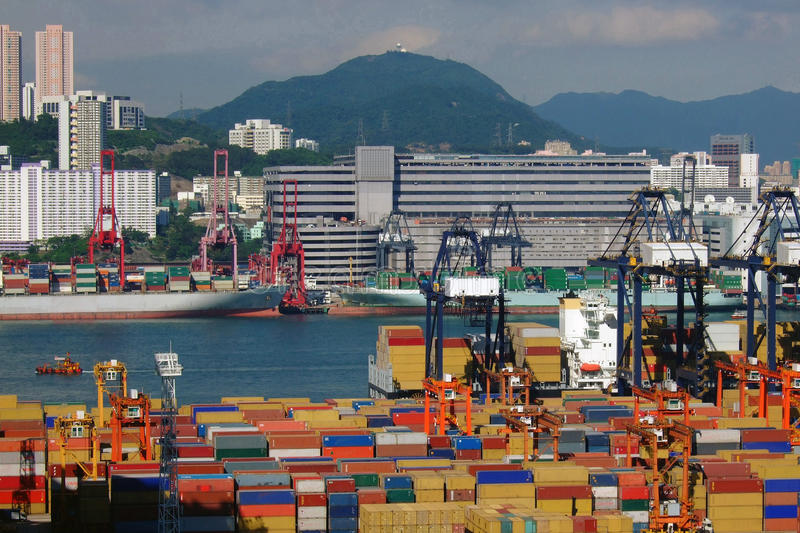 Container Terminals. Containerization (or containerisation) is a system of intermodal freight transport using standard intermodal containers as prescribed by the royalty free stock images
