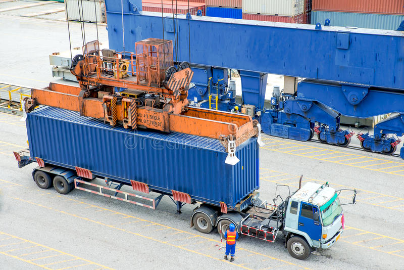 Container truck waiting for loading container box to Cargo ship stock photo