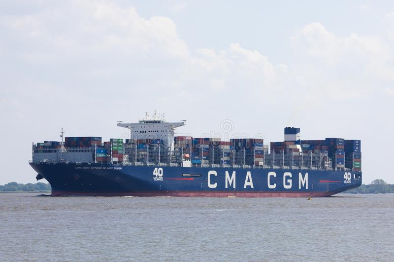 Container vessel CMA CGM Antoine de Saint Exupery on Elbe rivre. Stade, Germany - May 18, 2019: Container vessel CMA CGM Antoine de Saint Exupery on Elbe river stock photo