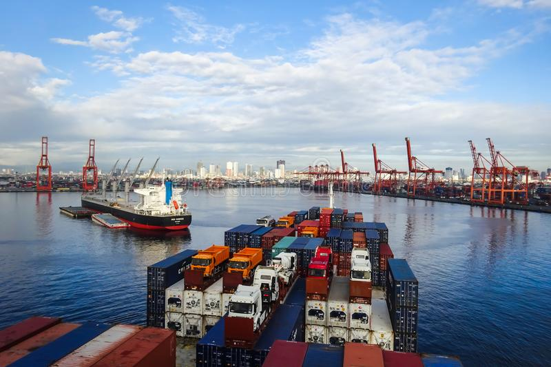 Container Terminal in the port of Manila, Philippines. Container vessel entering the port of Manila North, Philippines - entering maneuver stock photo