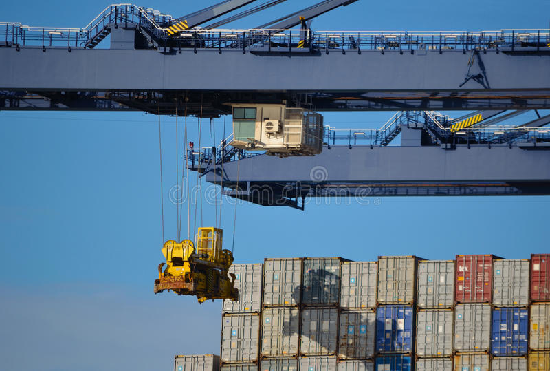Containers being unloaded stock photo