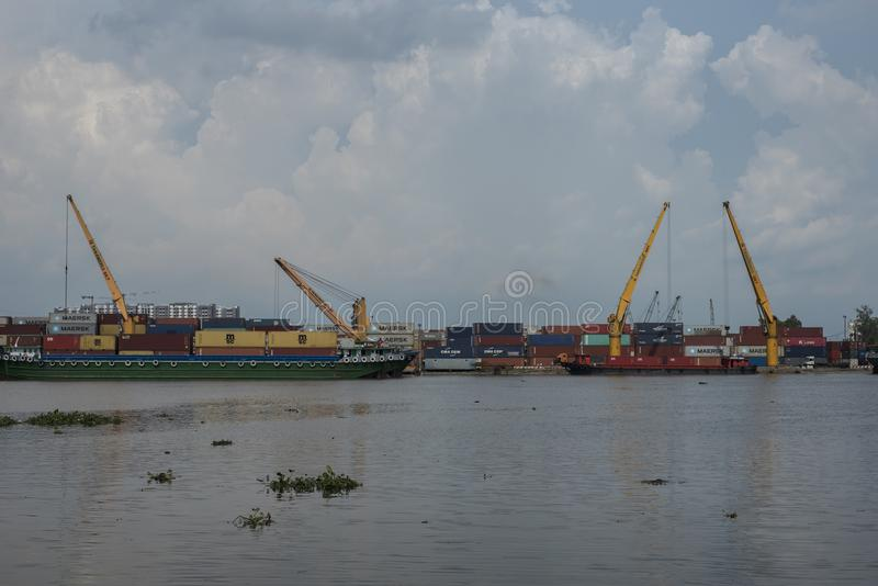Containers are being unloaded from a ship in Ho Chi Minh City, Vietnam royalty free stock photo