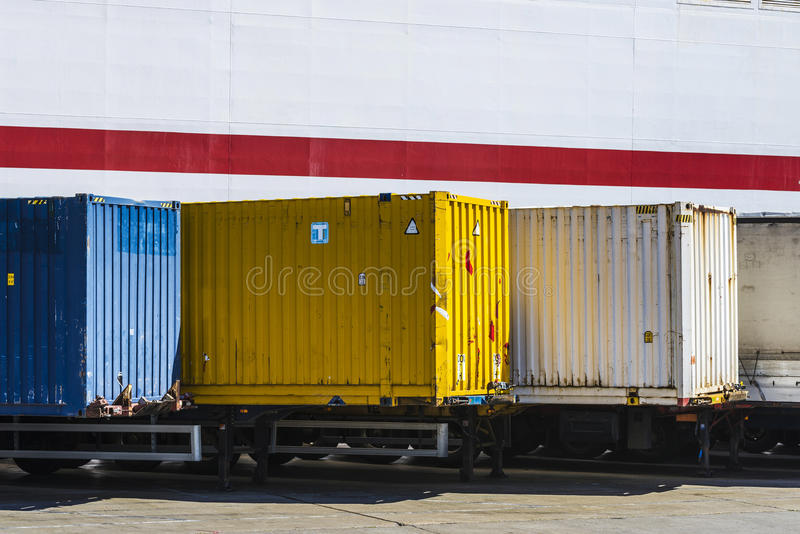 Containers parked in a row. Waiting to board at the port of Barcelona, Catalonia, Spain stock photography