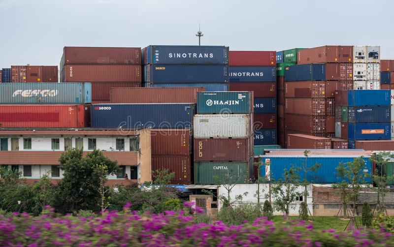 Containers stacked in Port of Xiamen in China. XIAMEN, CHINA - OCTOBER 31, 2018: Containers stacked and ready for shipping in Port of Xiamen stock photography