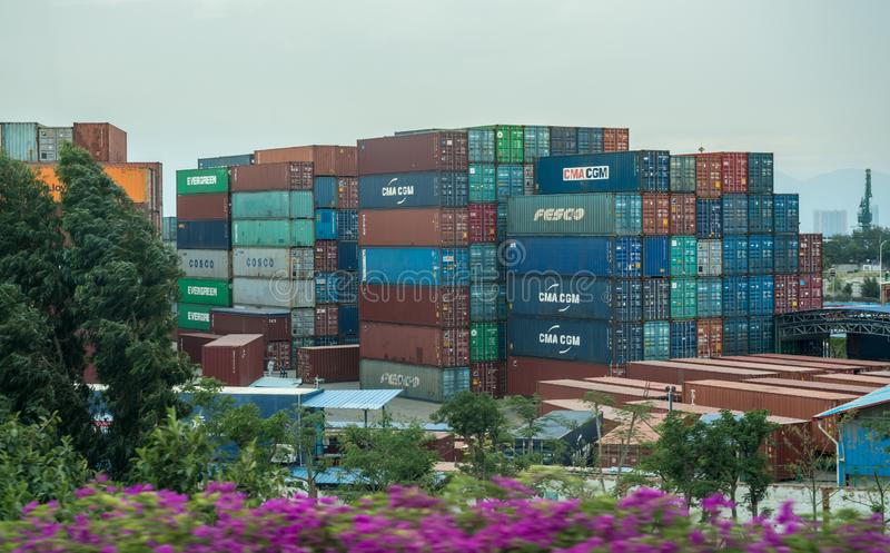 Containers stacked in Port of Xiamen in China. XIAMEN, CHINA - OCTOBER 31, 2018: Containers stacked and ready for shipping in Port of Xiamen stock photo