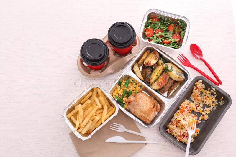 Containers with tasty takeout meals on light background, top view. Food delivery stock photo
