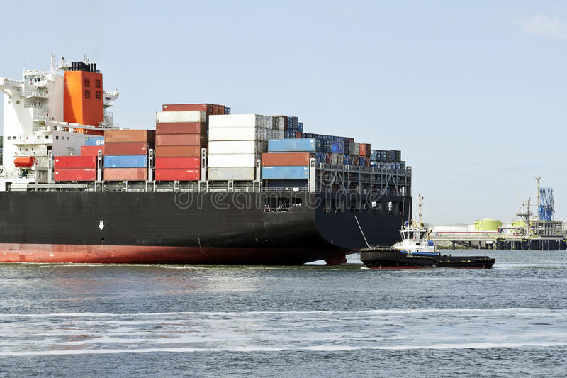 Containership with pilot boat stock photos