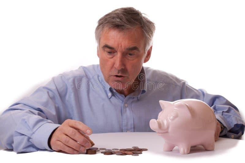 Contando as moedas de um centavo foto de stock royalty free