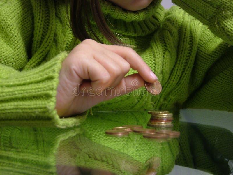 Contando moedas de um centavo imagens de stock royalty free