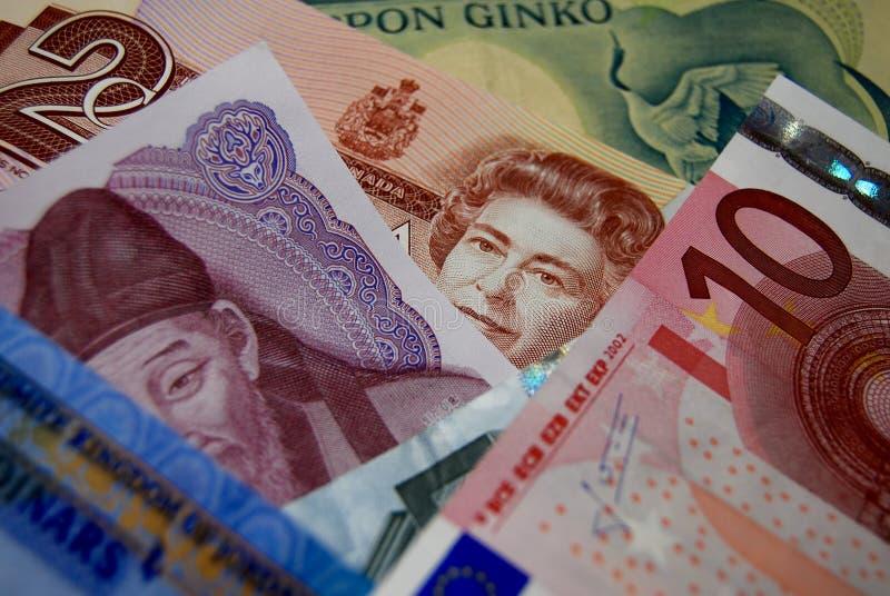 Contas coloridas das cédulas da divisa estrageira fotos de stock royalty free
