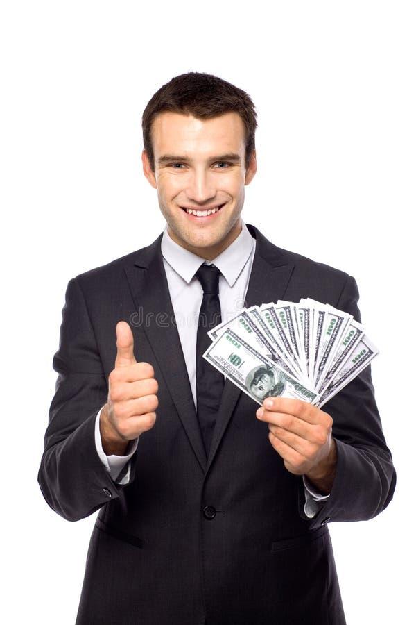 Contas de dólar da terra arrendada do homem de negócios imagem de stock