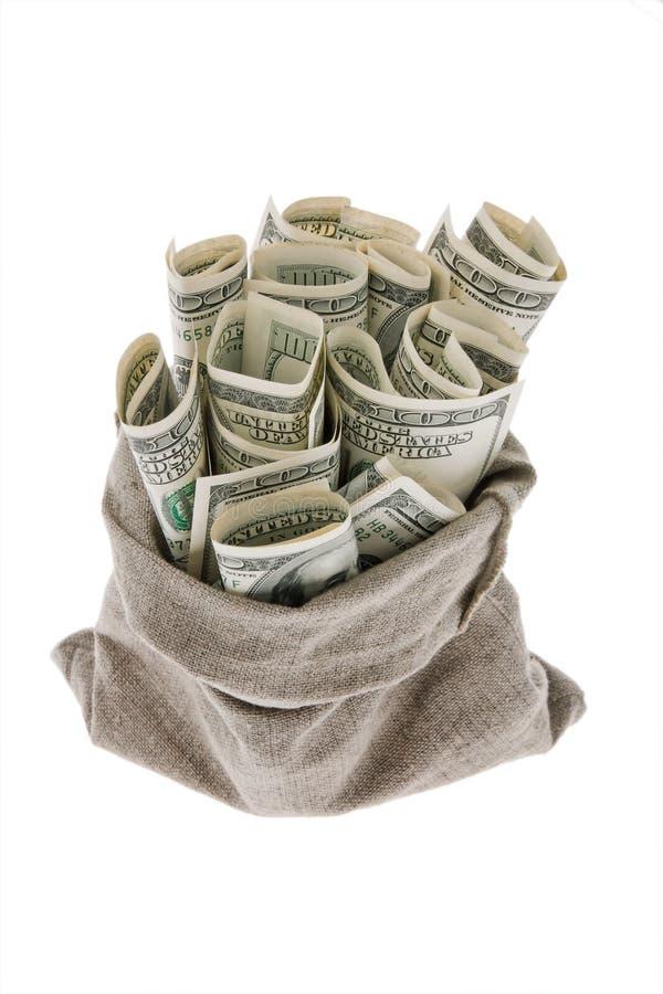Contas de dinheiro do dólar em um saco imagem de stock