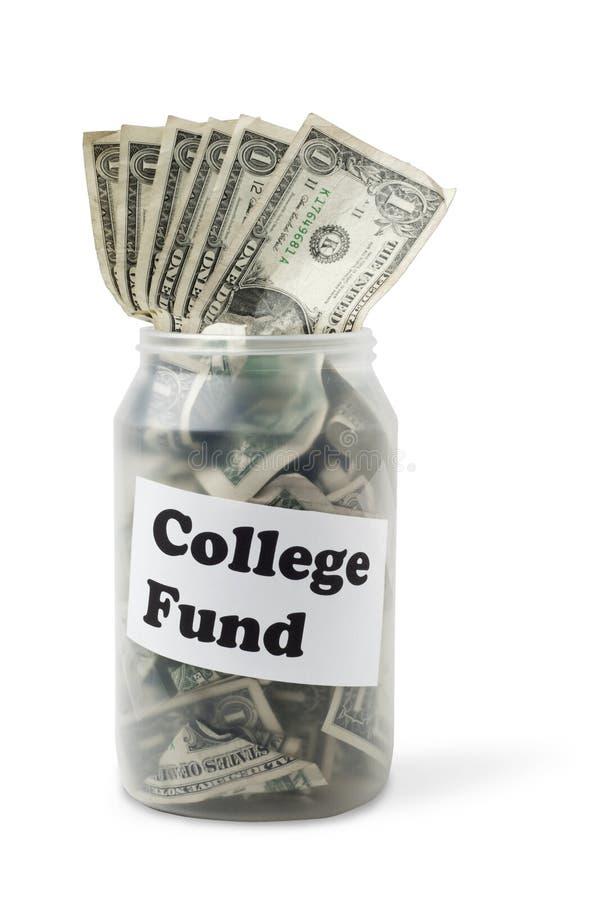 Contas de dinheiro do fundo da faculdade no frasco plástico fotografia de stock royalty free