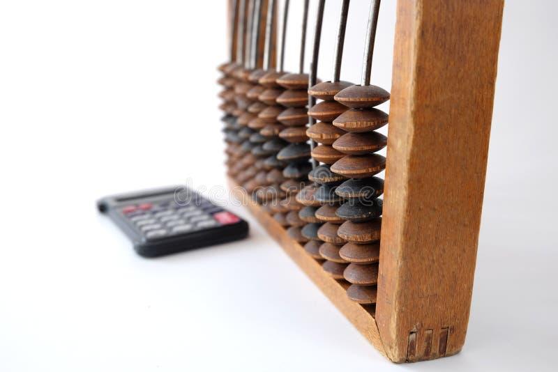 Contas e calculadora velhas fotografia de stock royalty free