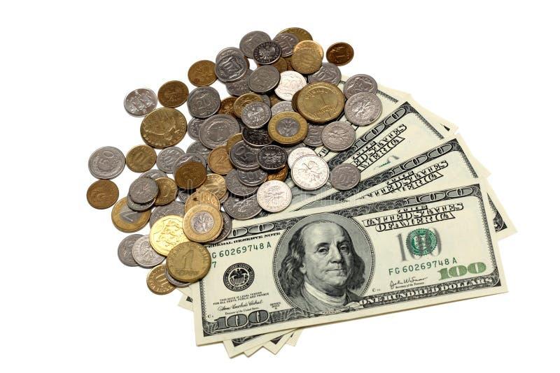 Contas e moedas de dólar fotografia de stock royalty free