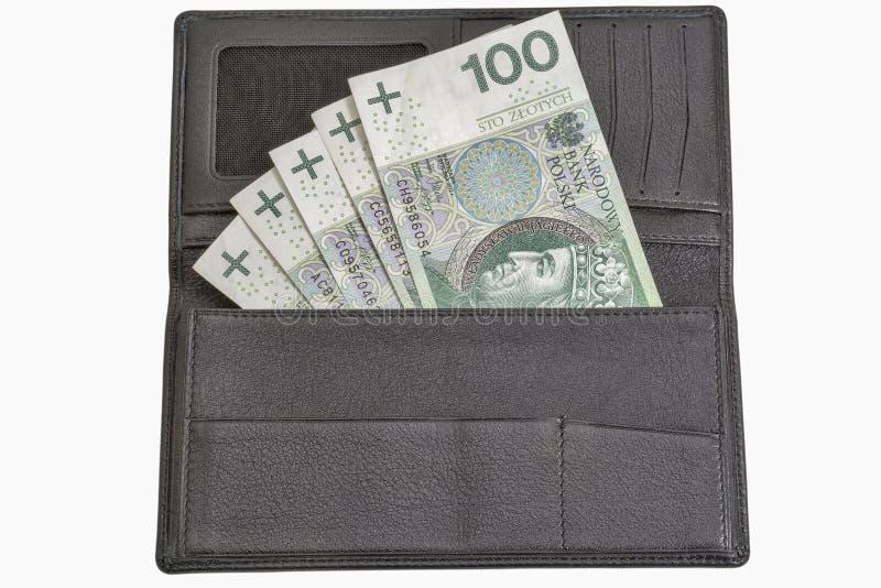 Contas polonesas do zloty na carteira de couro preta isolada no branco fotos de stock