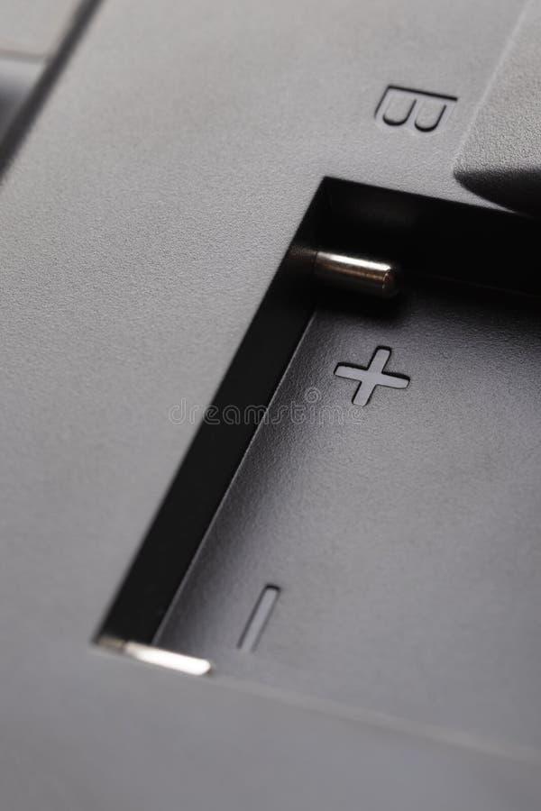 Contatti brillanti del connettore per la batteria in una cassa nera di plastica fotografie stock libere da diritti