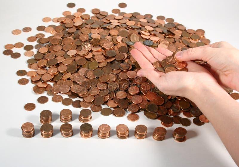 Conteggio dei penny fotografia stock