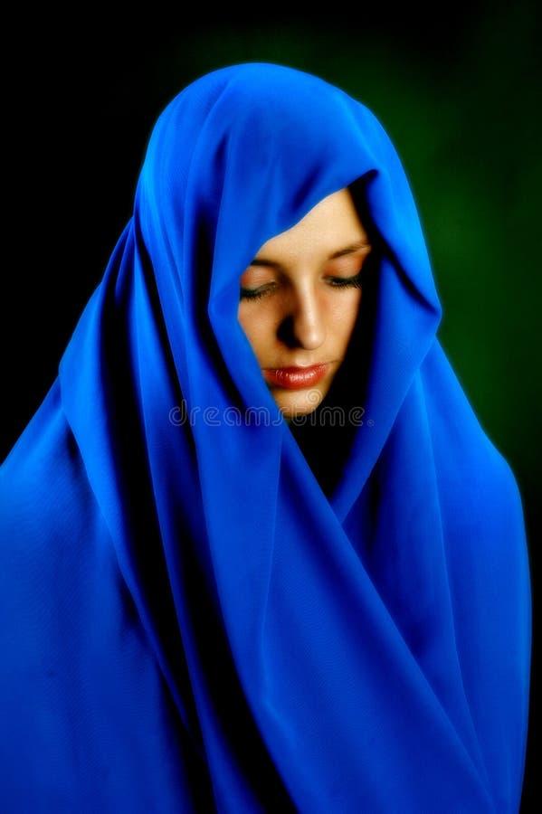 Contemplación en azul fotografía de archivo libre de regalías