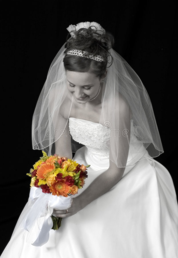 Contemplation. Bride black and white with full color flower bouquet stock photos