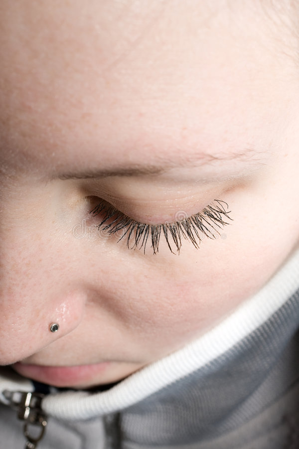 Contemplative. Girl looking down, half face shoot royalty free stock images