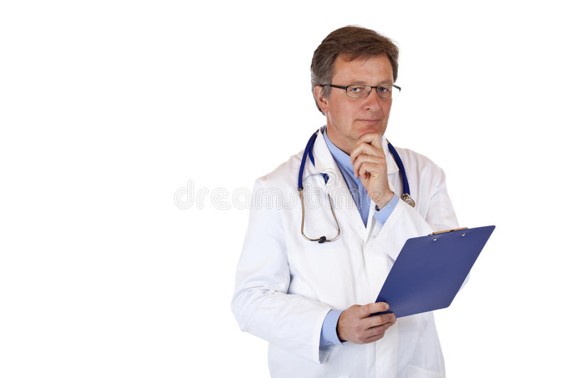 Contemplative doctor holds medical report stock images
