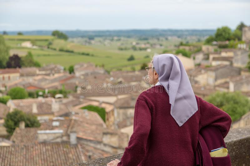 Contemplative nun over a nice old city stock images