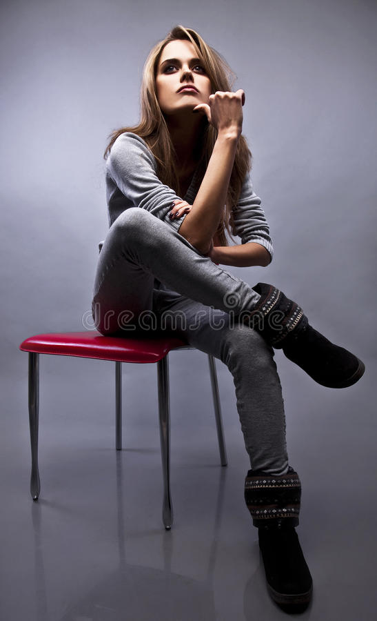 Contemplative Woman. A contemplative woman sitting and thinking royalty free stock photos