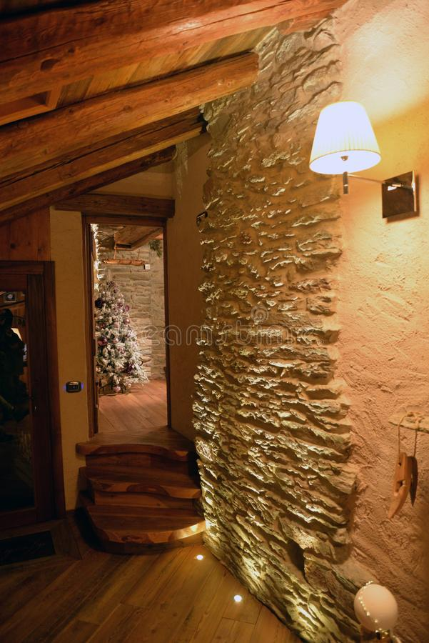 Alpine mountain house interior design. Modern and traditional atmosphere royalty free stock images