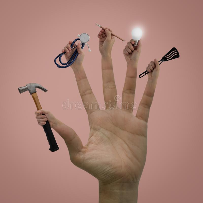 Contemporary art of Hands with a hammer, spoon, pen, lamp and stethoscope  on pink bacground. Idea concept for career royalty free stock images