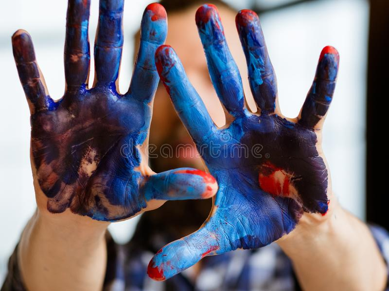 Contemporary art trend creative inspiration hobby. Contemporary art trend. Creativity inspiration and hobby concept. Closeup of man hands dirty with blue and red royalty free stock images