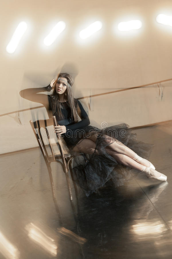 Contemporary ballet dancer on a wooden chair on a repetition royalty free stock photography