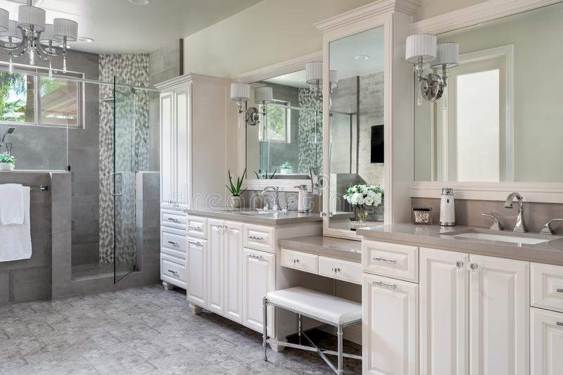 Contemporary residential bathroom remodel design walk-in shower. Contemporary, residential bathroom remodel, design, construction with walk-in shower and dual royalty free stock image