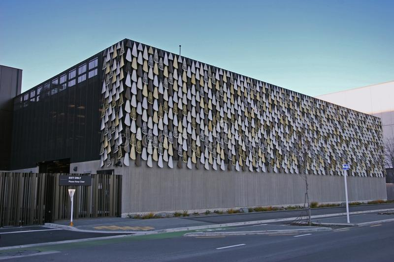 Modern car park garage of Justice and Emergency Service Precinct of Christchurch, New Zealand. Inspired by kakapo bird feathers. Contemporary building of car stock photo