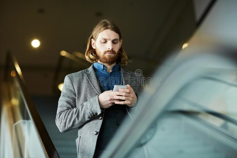 Texting on the move stock photography