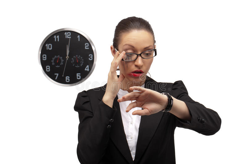 Contemporary Cinderella. Business lady watching on clock... Oops, it's already 12 o'clock, time to loose all her beauty starting from make up royalty free stock photos